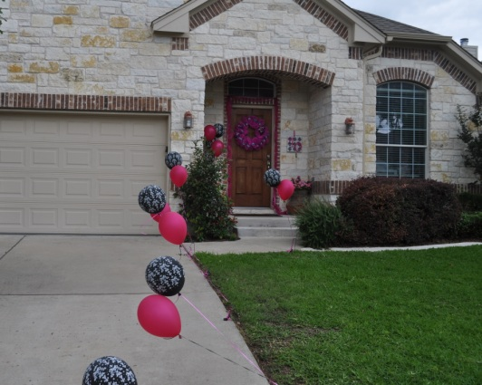 White/Damask and Hot Pink Balloons lined the driveway in front of the house.